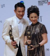 Hong Kong actors Deanie Ip (R) and Andy Lau on after winning awards for their roles in the film