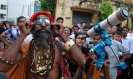 Indians gaze into space as they watch the Transit of Venus in June