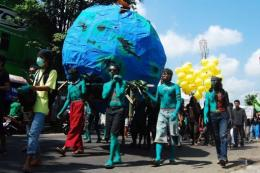 Indonesian environmental activists parade during a protest to mark Earth Day