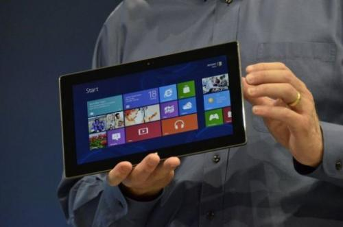 Microsoft's CEO Steve Ballmer holds the new Surface