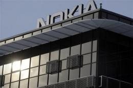 Nokia lowers profit outlook, shares nosedive (AP)