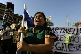 Panamanian natives shout slogans during a protest against the government in Panama City on February 5