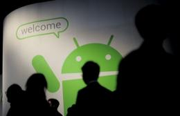 Participants visit the Android stand of the Mobile World Congress in Barcelona in February