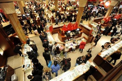People crowd the aisles inside a Macy's department store after the midnight opening on