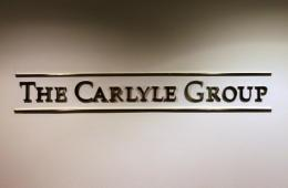 Private investment group The Carlyle Group completed its deal to take over the photography agency Getty Images