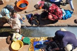 Residents of Imiter, Morocco, wash clothes at the village wash-house