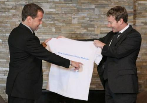 Russian Prime Minister Dmitry Medvedev (left) receives a T-shirt as a present from Facebook CEO Mark Zuckerberg