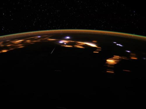 Stunning lyrid meteor over earth at night