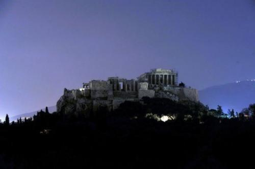 The Acropolis hill is pictured with its lights switched off