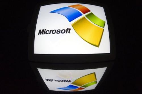 The Microsoft logo is seen on a tablet screen on December 4, 2012 in Paris