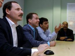 Then-Russian President Dmitry Medvedev (2ndL) meets with Arkady Volozh (1stL), CEO of Yandex