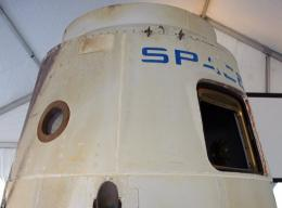 The SpaceX Dragon spacecraft, bearing brown and black scorch marks from its fiery tour in orbit, is pictured in 2011