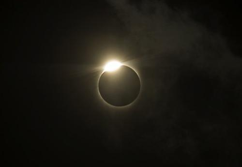 The sun is covered by the moon during a total solar eclipse in the Indian city of Varanasi in 2009