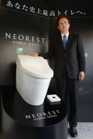 The Washlet's functions include water jets with pressure and temperature controls, and hot-air bottom dryers