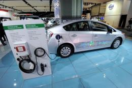 Toyota Prius plug-in hybrid car is shown on display at the 2012 Detroit Auto Show