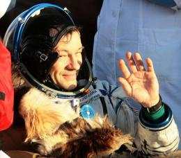 US astronaut Michael Lopez-Alegria waves shortly after the landing of Russian Souyz TMA-9 space capsule in 2007