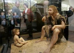 Visitors of the Museum for Prehistory in Eyzies-de-Tayac look at a Neanderthal's reconstruction in 2004