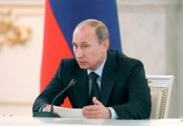 Vladimir Putin hailed a series of tie-up with foreign oil firms to explore the Arctic