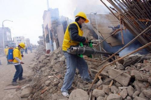 Volunteers dig through the rubble after an earthquake in Peru, which sits on the Nazca tectonic plate