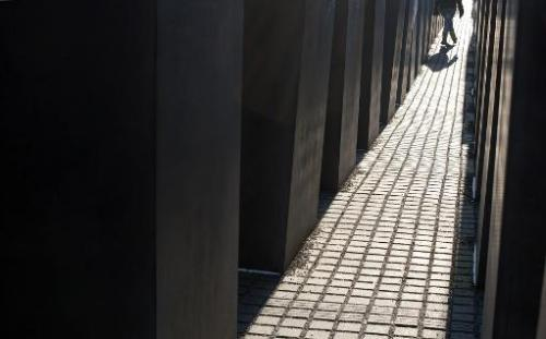 A person walks past concrete steles at the Holocaust Memorial in Berlin, on January 31, 2012