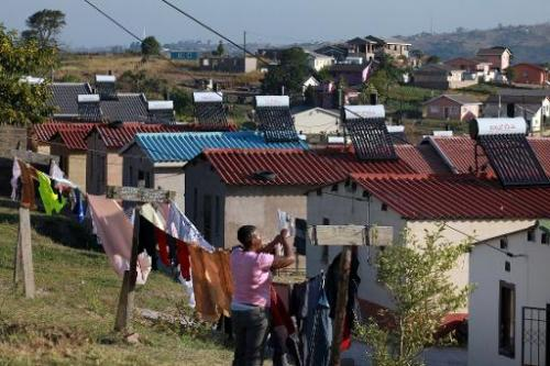 A picture from June 22, 2011 shows homes in Demat, 57 kms south of Durban, with solar water heating panels on their roofs