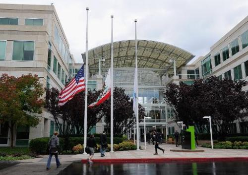 Apple employees arrive to work at the Apple headquarters on October 5, 2011 in Cupertino, California