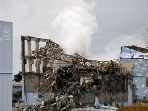 A Tepco picture from March 15, 2011 shows smoke rising from unit 3 reactor building at the Fukushima nuclear plant