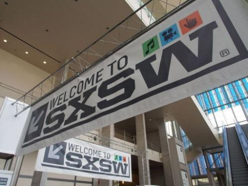 Banners hang in the atrium of the Austin Convention Center on Thursday, March 7, 2012