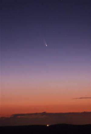 Comet posing beside crescent moon in cool photo op