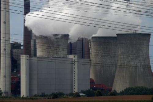 Exhaust rises from cooling towers at theNeurath lignit coal-fired power station at Grevenbroich on September 11, 2012