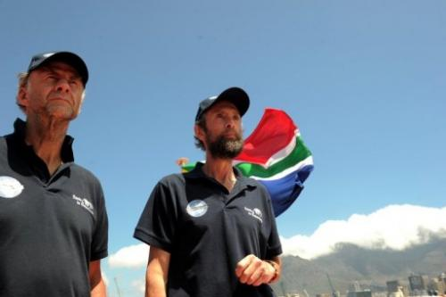 Explorers Sir Ranulph Fiennes (L) and Anton Bowring meet journalists on January 6, 2013, in Cape Town