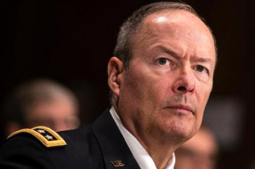 General Keith Alexander, Director of the National Security Agency, listens during a hearing of the Senate Judiciary on Capitol H