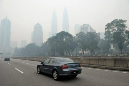 Haze shrouds Malaysia's Petronas Twin Towers in Kuala Lumpur on June 23, 2013
