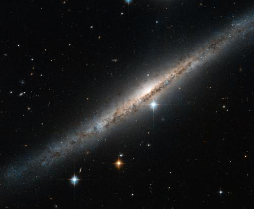 Hubble Catches a Side-on Spiral Streak