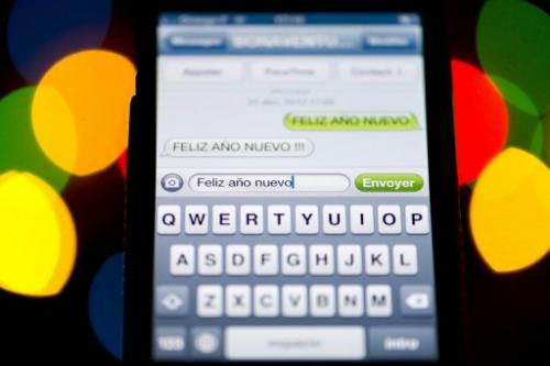 Illustration photo show SMS text messages displayed on a a smartphone