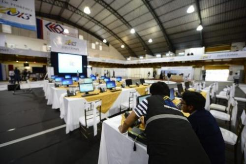 Members of the National Election Council check final details on the eve of general elections in Quito, February 16, 2013