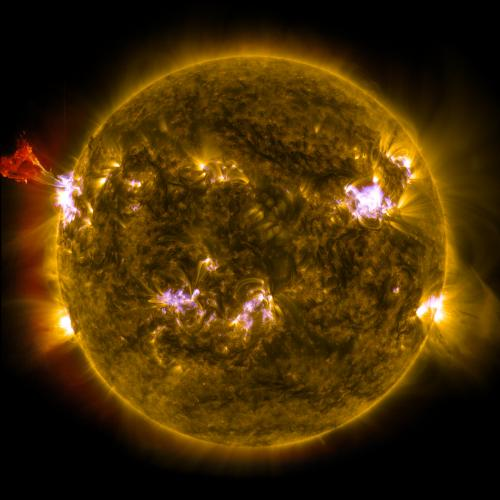 NASA sees sun emit mid-level flare