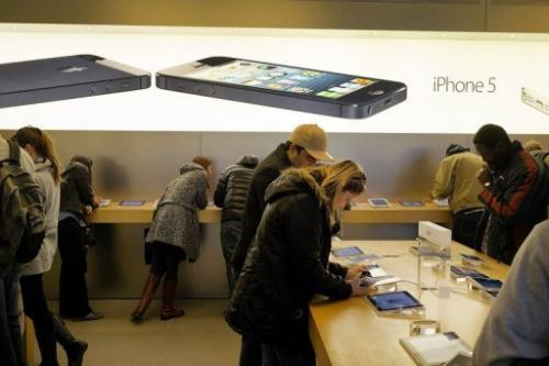 People browse at an Apple store on January 14, 2013 in New York City