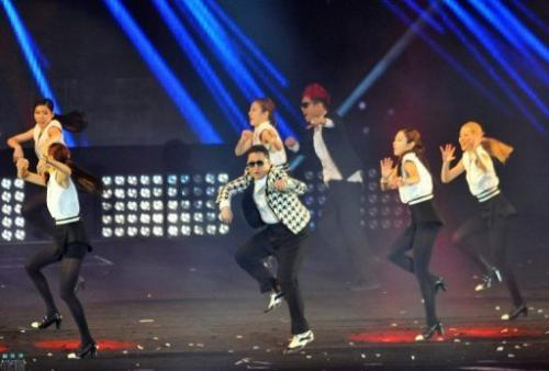 """Gangnam Style"" star Psy (C) perform his new single ""Gentleman"" at a  concert in Seoul on April 13, 2013"
