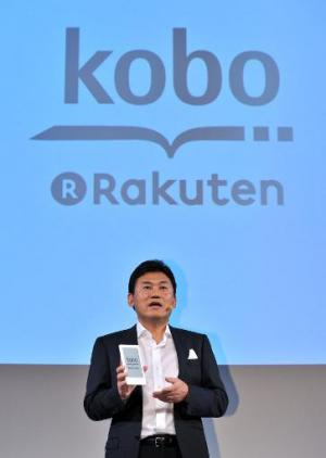 "Rakuten chairman and CEO Hiroshi Mikitani launches the company's electronic book player ""Kobo Touch"", in Tokyo on July"