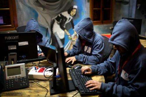 "Trainees work at the ""Cyber Gym"" centre, where IT and infrastructure company employees train to defend against cyber a"