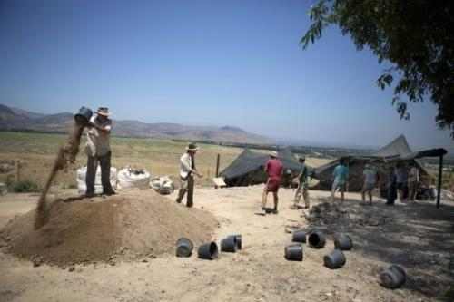 Volunteers from Hebrew University work at an excavation at the Israeli archeological site of Tel Hazor on July 9 2013