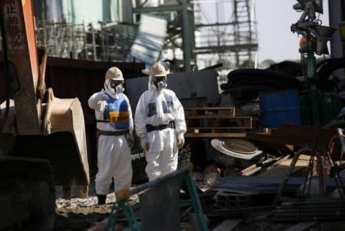 Workers wearing protective clothing at the Fukushima nuclear power plant on March 6, 2013