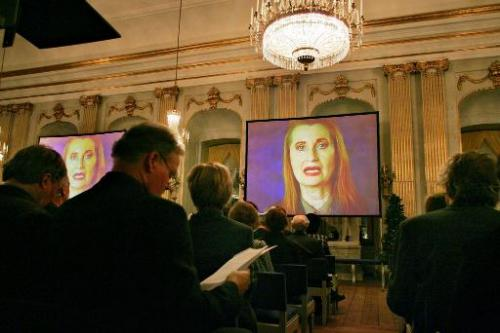 A picture taken on December 7, 2004 shows Nobel Prize winner Austrian Elfriede Jelinek (on screen) during a videotaped prize lec