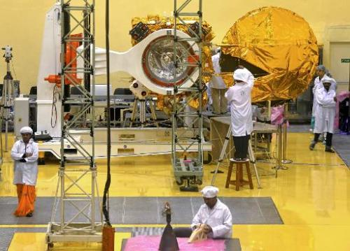 File pictures show scientists and engineers working on a Mars Orbiter vehicle at the Indian Space Research Organisation's (ISRO)
