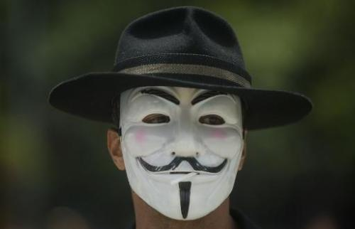Illustration: hackers from Anonymous, who often wear Guy Fawkes masks similar to the one pictured when making public statements,