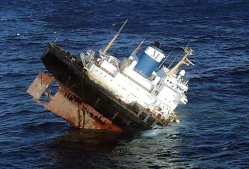 File picture shows an aerial view of the stricken Bahamas-flagged tanker Prestige, November 19, 2002, off Cayon, northwestern Sp