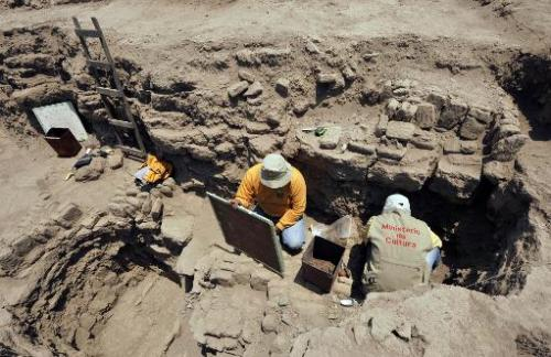 "Archaeologists work at the pre-Inca religious complex ""Huaca Pucllana"", in the residential district of Miraflores, in"