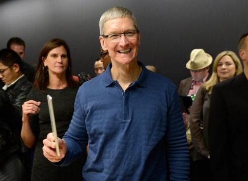 Apple CEO Tim Cook displays the new iPad mini on October 23, 2012 in San Jose, California