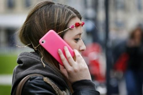 A woman uses her smartphone in Bordeaux, France on May 3, 2013